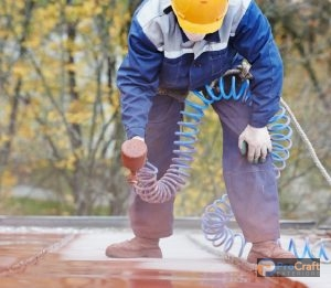 Commercial Roof Replacement Spraying