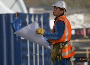 A Roofing Specialist Examines a Project