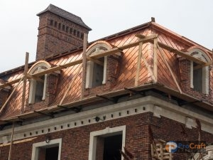 Copper Roofing System With Brick Chimney