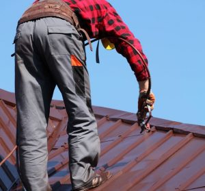 Worker Applies a Protective Coating