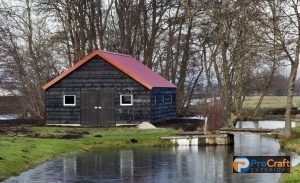 Red Roofed Farmhouse by the River